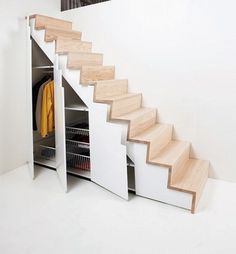 Under the stairs becomes a huge opportunity for storage in a small space.