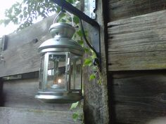$3.99 lantern from IKEA, very cute addition to our back fence.