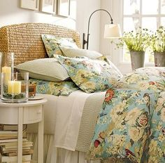 Rattan headboard, white furniture and pastel floral bedding....pure bliss!