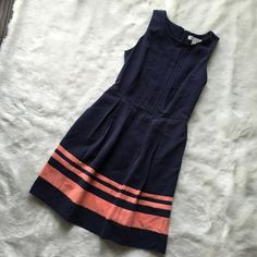Navy & Coral Pleat Dress Classic feminine dress. Pair with some oversized sunglasses and a top knot...voilà you are Audrey Hepburn. No flaws. Feels like silk, but is modal. Dresses Mini