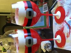 Wine glasses painted like Santa! Using acrylic glass paint. Find wine accessories though link below