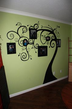 family tree wall art... Adorable!!! I might start tearing out our deeply textured drywall and start replacing it so I can do things like this!!