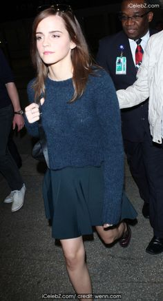 Emma Watson arrives at Los Angeles International Airport (LAX) walking in brogues and matching skirt and wool top http://www.icelebz.com/events/emma_watson_arrives_at_los_angeles_international_airport_lax_walking_in_brogues_and_matching_skirt_and_wool_top/photo3.html