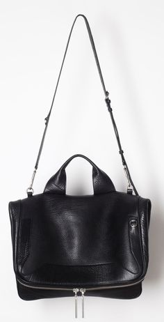 "3.1 Philip Lim.  I think that I should own this bag. It screams my name but unfortunately my bank account screams back ""Forget About It""  CM"