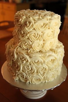 buttercream frosting wedding cake pictures | Top tier butter cake, bottom tier chocolate with chocolate peanut ...