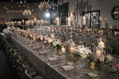 estate tables with low centerpieces and candles.