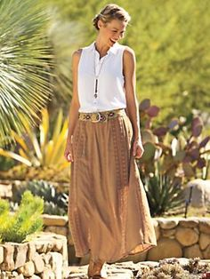 You know that woman who can bake bread, tile a patio, tack up a horse, make it look easy? We'll never be her, but we can dress the part in the Canyon Lady Maxi Skirt. Light and flowing, streaming with lace and lined to the knee for a little sexy see-through.