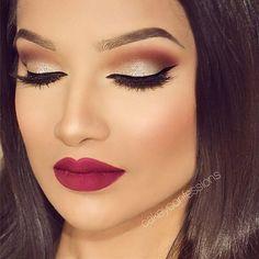 shimmery gold brown cat eye makeup, plum lips