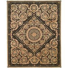Update your home decor with euro-inspired hand-carved finish area rug. This hand-knotted European-style area rug has a multi-colored background and displays stunning panel colors of black, brown and beige.