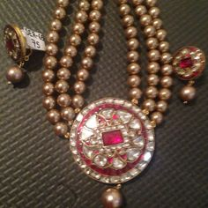 Lovely Polki (uncut diamonds) pendant and tops in 22 karat gold and rubies with pearls Avialable now price and details upon request