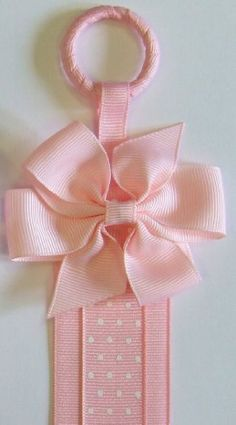 Boutique Hair Clip & Hair Bow Holder (Pink Bow/Pink Dot Ribbon) Funny Girl Designs, http://www.amazon.com/dp/B003ZZNSN8/ref=cm_sw_r_pi_dp_OqZeqb0Z17ZGX