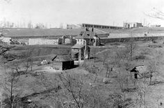 Biltmore House- exterior- construction of walled garden in foreground with house base in background