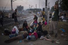 Germany has welcomed all Syrian asylum seekers to remain in the country in a monumental step to try to resolve the refugee crisis in Europe, dismissing a 1990 protocol that stip...