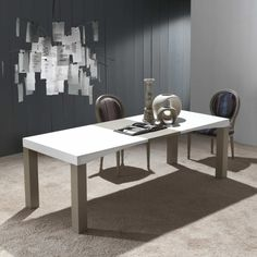 Fixed and extendable table with carved arch-shaped folding top | milanomondo