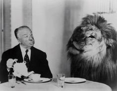 Alfred Hitchcock taking tea. With friend.