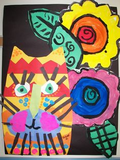 First Grade Laurel Burch Cats. Link does not work! Cat head can be made using symmetry. Collage. Painted flowers and a little extra paint for cat freckles and cheeks