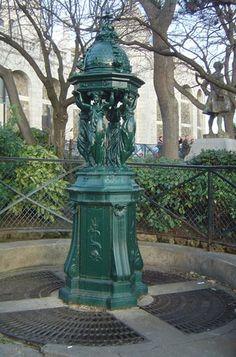 A Wallace fountain located in the Montmartre district of Paris, designed by Charles-Auguste Lebourg, cast iron (Copyright © 2005 David Monniaux) Montmartre Paris, Monuments, The Englishman, Fountain Design, Paris Travel Guide, Wax Museum, Tourist Trap, Romantic Photos, Paris Ville