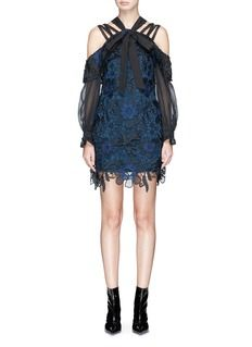 self-portrait presented floral guipure lace with beautiful 3D daisy appliqué in its AW17 runway collection, as echoed in this mini dress. Topped with shoulder sashes that can be tied into a pussybow, this frock is cleverly cut to project a flattering off-shoulder impression. Take notes from runway and style yours with patent ankle boots.