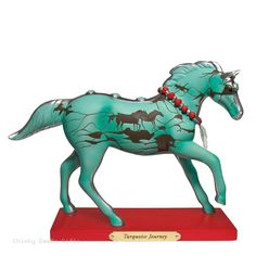 Enesco Trail of Painted Ponies Turquoise Journey Figurine MPN: 4053784 ARTIST: Devon Archer CONDITION: New DATE INTRODUCED: 4/1/2016 SIZE: 6.5 in H x 2.5 in W x 8.3 in L MATERIAL: Stone Resin, Brass 1