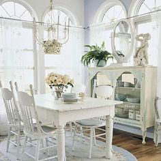 This is a lovely room....  I love the side piece with the mirror.  It would look great with painted floors, too!