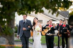 bride and groom entering the reception at los angeles wedding with mariachi band photography