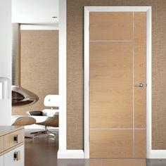 The Caserta oak door has a distinctive modern aluminium inlay on a decorative oak. #oakdoor #internaldoor #flushdoor