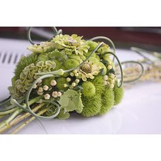 Wedding car decoration with dianthus 'green trick', celosia, green spray chrysanthemums and symphoricarpos (snowberry) by Philippe Bas. philippebas.be