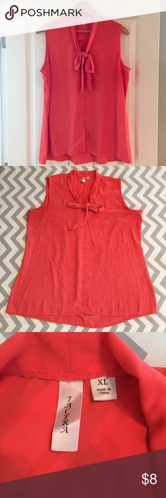 Tacera Pussybow Blouse Lovely reddish orange sleeveless top with pussybow tie at neck. Button down front. 23 in across the bust, 27.5 in length. There is some small discoloration near the top three buttons shown in 4-5. It is incredibly faint and the first two you don't see at all when worn as they fall under the bow. VGUC. Tacera Tops Blouses