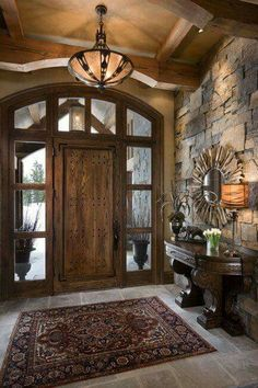I live the feel of this. The gray stone, dark wood, great stone floor, light walls.... Definitely the right feel for basement Cabin Homes, Log Homes, Rustic Entryway, Rustic Interior Doors, Interior Stone Walls, Rustic Front Doors, Open Entryway, Rustic Walls, Unique Front Doors