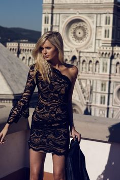 black lace. one sleeve.  I LOVE THIS DRESS