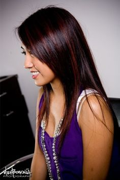 spice up rich brunnette hair with a punchy highlight like this magenta