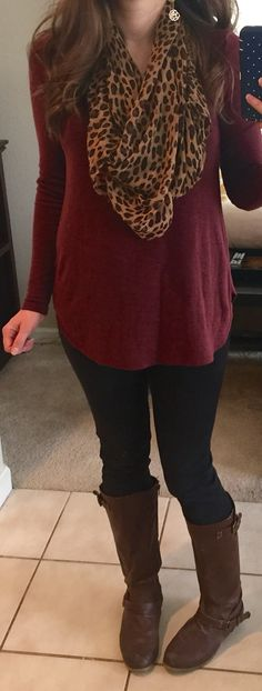 Leopard print scarf, maroon tunic, black jeggings, brown riding boots.