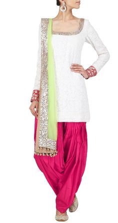 Manish Malhotra Ivory and red chikankari short kurta set. It comes with a pink silk salwaar and neon green net dupatta. FABRIC: Chikan and net.