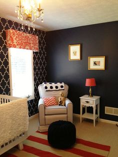 I love this color pallet for a living room! Quatrefoil navy plain wall with the patterned wall. Also that striped rug is gorgeous!