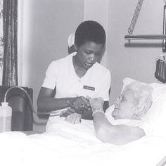 A nurse assists a patient at St. Dominic Hospital.