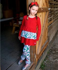 3-tiers of ruffles adorn this soft and stretchy long sleeve tee. Perfect for pictures or a day of play, this top is comfy and cute. Pair with Everyday Ruffle Leggings for a stylish outfit.