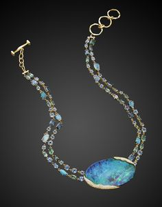 "If you want to fall in love with opals (and tourmalines!), look no further than Mimi So's ""ZoZo"" boulder opal necklace. The necklace, a personal favorite from this year's Couture Design Awards, holds a mesmerizing 147.53-carat boulder opal set with organic pavé diamond detailing."