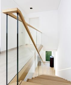 />Zigzag stair made of oak. Balustrade made of glass with wooden handrail. Stairs of the TECHNE line. Private residential project, designed by TRĄBCZYŃSKI. Glass Stair Balustrade, Oak Handrail, Staircase Railings, Glass Railing, Staircases, Railing Design, Staircase Design, Staircase Ideas, Glass Stairs