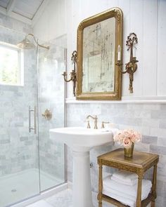 Yesterday I bought a pedestal sink for our powder room. I am beyond excited to add some love to that tiny little space. Of course when you start changing a room one little decision leads to five more ... and now I am quickly hunting a new mirror and sconces. How amazing are these? And that shower ... can I add it to my cart as well? This might be bathroom perfection ... don't you agree? Happy Monday! Design by @frenchcountrycottage