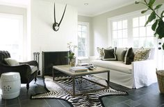 Suzie: Ashley Goforth Design - Modern, chic living room design with white slip-covered sofa, . Chic Living Room, Home Living Room, Living Room Designs, Living Spaces, Transitional Living Rooms, Fireplace Design, Brick Fireplace, Design Blog, Design Ideas