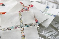 little cross quilt squares... don't use much expensive fabric, very catchy and would look great with a contrast sashing