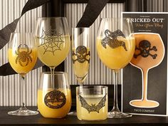 Bling up a wine glass or juice glass for a Halloween Party! Rhinestone icons at craft stores - like Michaels.