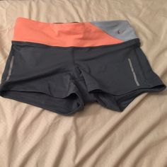 Nike Dri-Fit Shorts Never been worn or washed, straight from the store! Tight fitting shorts, great for all activities. Zip pocket in the back. Nike Shorts