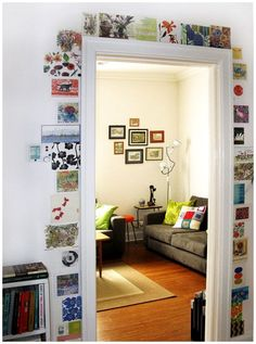 Wall art doorway. cool patterns. destination photos. family photos. printed quotes. this could be my solution to picture frames.