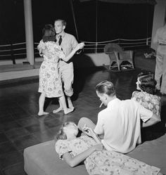 """""""US Navy pilots on leave dancing with their dates at the Chris Holmes Rest Home in Hawaii"""""""