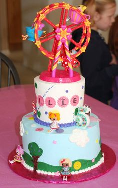 Lalaloopsy Cake. Great way to incorporate all of her lalaloopsy dolls/playsets
