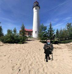 Bernie Sanders' mittens visit a lighthouse at the beach Bernie Sanders, Vermont, Mittens, Lighthouse, Memes, Beach, Fingerless Mitts, Bell Rock Lighthouse, Light House