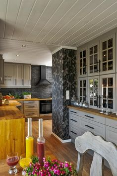 Kitchen, hardwood floor, grey cabinets, butcher block countertop, stone backsplash