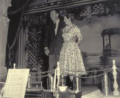 Walt Disney and his wife celebrate their wedding anniversary at the Golden Horseshoe Saloon a few days before the opening of Disneyland