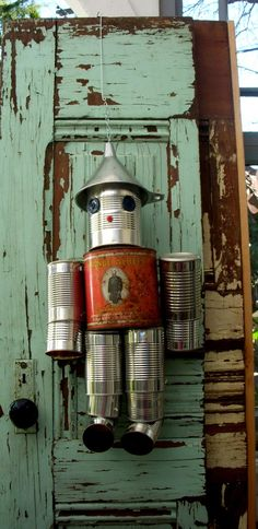 I already have all of the cans saved up - and the tin (aluminum) funnel was hardest to find! Handcrafted Tin Man - Prince G. Tin Can Crafts, Arts And Crafts, Diy Crafts, Cuadros Diy, Tin Can Art, Craft Projects, Projects To Try, Diy Upcycling, Tin Man